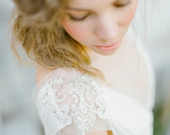 Non-corset silk wedding dress with a handmade embroidery on the shoulders