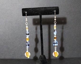 "Handmade dangle earrings in blues and oranges - 2 1/2"" long"
