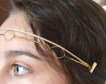 Your gold headband.