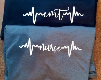 Nurse, emt, or hospital staff rhythm shirt.