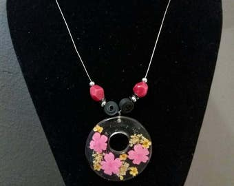Air Chamber and resin pendant necklace with real dried flowers.