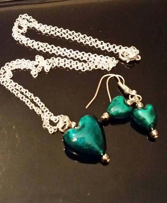 Turquoise / teal coloured glass drop earring and pendant set.
