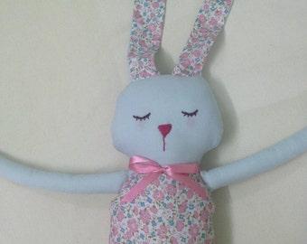 Flying high rabbit doll