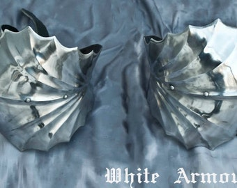 SCA gothic combat steel elbow cops, fluited and articulated.