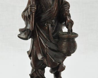 Chinese hardwood carved sculpture of a man.