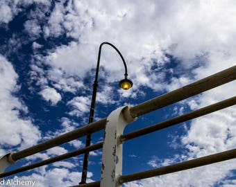 St.Kilda pier lamp post against a cloudy sky - color photography