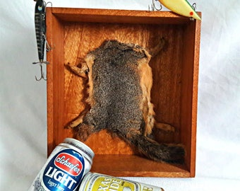 Cool Stuff. Squirrel Pelt, Vintage Beer Cans. Vintage fishing lures, Vintage Wooden Box.