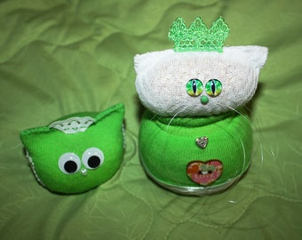 The green and white kitty and owlie - a couple of  Charming Plushie toys.