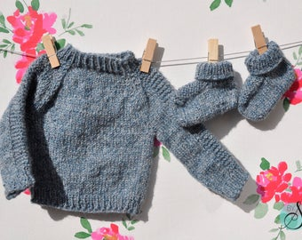 Handknit blue baby sweater