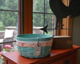 Vintage, round, painted, distressed, stained, farmhouse fabric and cotton trimmed, poly coated basket with the original liner.