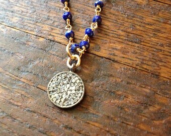 Diamond pave disc necklace on lapis rosary chain.