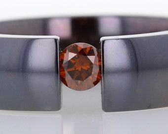 Treated round orange diamond ring
