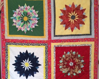 Quilt with raised flowers