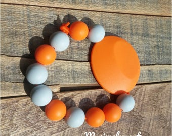 Teething toy. [Orange].
