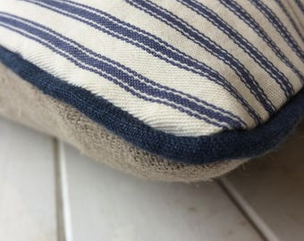 Blue ticking cushion with navy linen piping and raw linen backing.