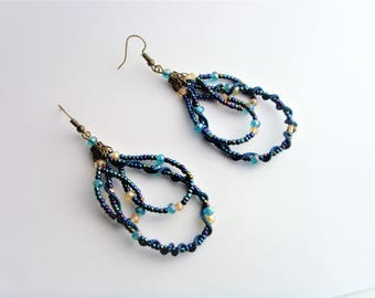 Earrings pearls blue and golden.