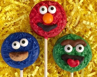 Sesame Street Oreo cookie pops / Elmo / Cookie Monster / Oscar the Grouch / birthday party favor / one dozen(12)
