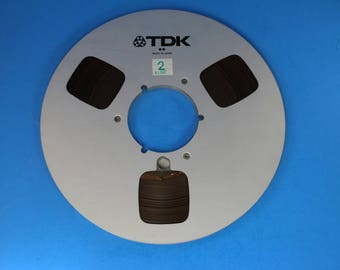 TDK 10.5 in metal aluminum take up reel with 1/4 in tape for reel to reel players in excellent condition