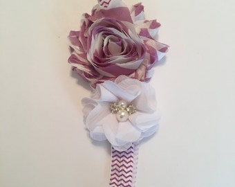 A sweet lavender and white headband with pearls embellishment