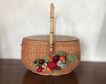 Vintage wicker basket with lid and faux fruit decor