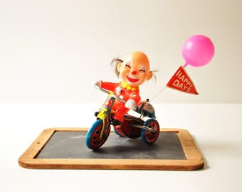Vintage Wind Up Tin Toy Clown on a Tricycle - Happy Day
