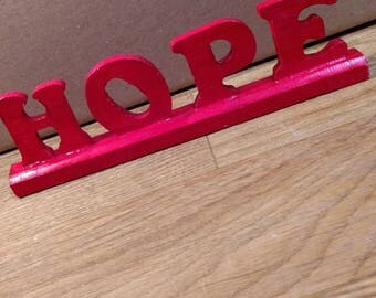 Wood word on stand - hope