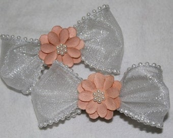 a pair of two small  white bows