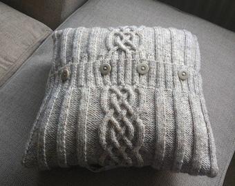 Hand knitted aran cushion