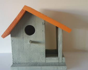 Handmade bird house from reclaimed wood