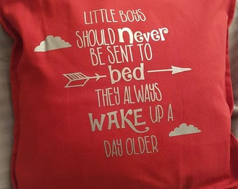 Peter Pan inspired cushion, little boy should never grow up red with silver writing