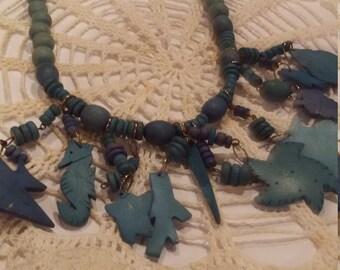 Vintage blue wooden ocean creature necklace