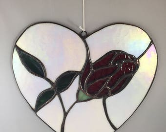 Stained glass heart with red rose