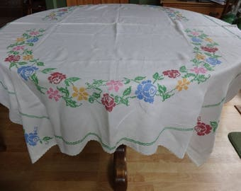 Cross stitched, crocheted linen table cloth