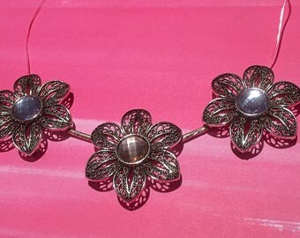 Three flowered Necklace on a Silver Chain
