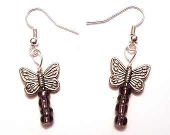 Silver butterfly charm earrings with purple beads
