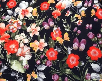 Floral with butterflies lycra/spandex-type jersey fabric 150cm, sold per metre