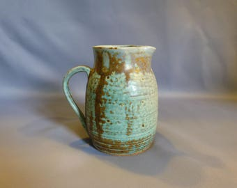Light turquoise pitcher