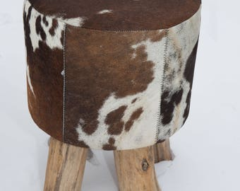 Coat stools made from cow skin / Bullhide round with wooden feet, brown-white