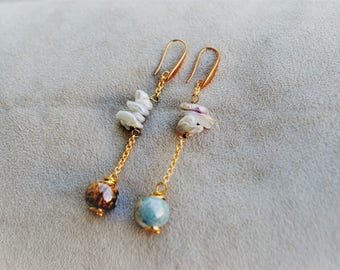 Earrings with freshwater pearls and handmade ceramic