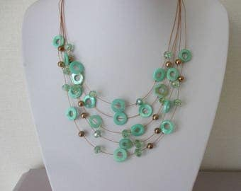 Multi-stranded green beads necklace