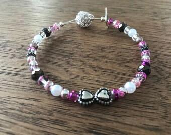 Black and pink love heart bracelet