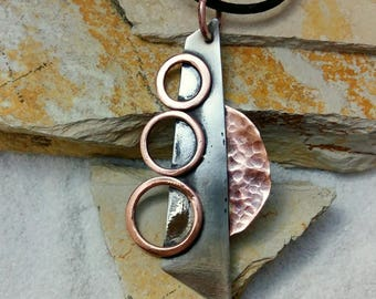 Stainless steel and copper pendant