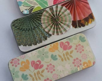 Trio of long thin tins. . . Flowers