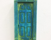 Blue Green cast plaster door sculpture