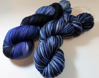 Hand Dyed Superwash Merino Sock Fingering Yarn (Choice of Three Bases) -- Geode (Blues, Black, Purples)