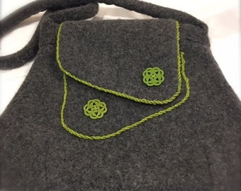Grey felted purse with green trim and decorative buttons