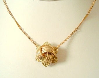 Vintage gold Tone Love Knot Button Necklace