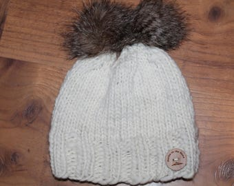 Hand Knit Merino Wool hat.  Super warm and soft.  One size fits most adults. Faux Fur Pom Pom.