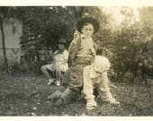vintage photo 1933 Ride em Cowboy toy gun Halter on Masked Child Eerie Abstract Mask Scary