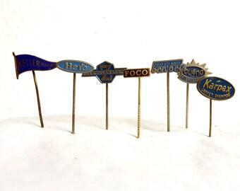 Vintage Lot 7 1960s Advertisement Stick Pins Small Metal Lapel Badges Bueno Hero Foco Bervoets Keller Karpex - European Brands Collectibles